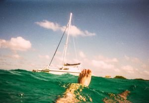 person drifting away from a boat